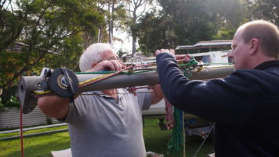Getting ready to position the new mast - fixing a tape to measure the sweep back.